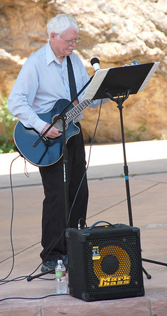 Rick Starr, playing his famous guitar at the July 2 freedom rally held in Performance Park.