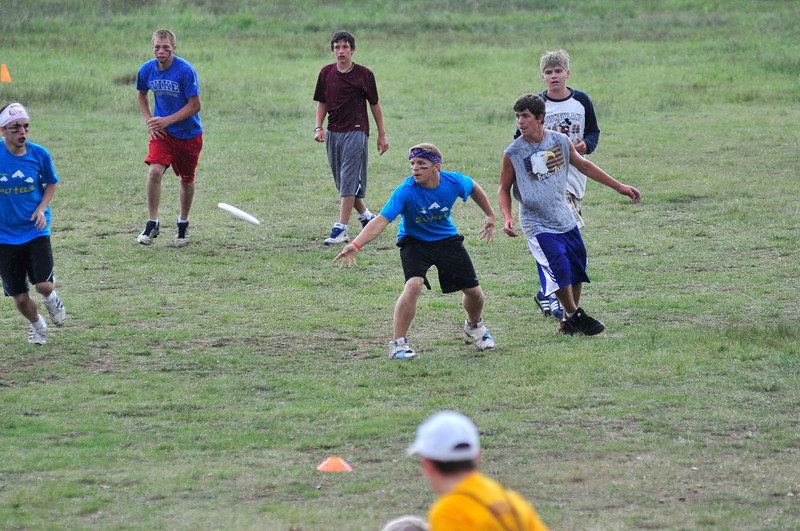 Walt Hester | Trail Gazette<br /> Boys at the YMCA of the Rockies play Ultimate during an afternoon shower on Wednesday. The game  resembles disc football, except without tackling and receivers are only allowed a limited number of steps.
