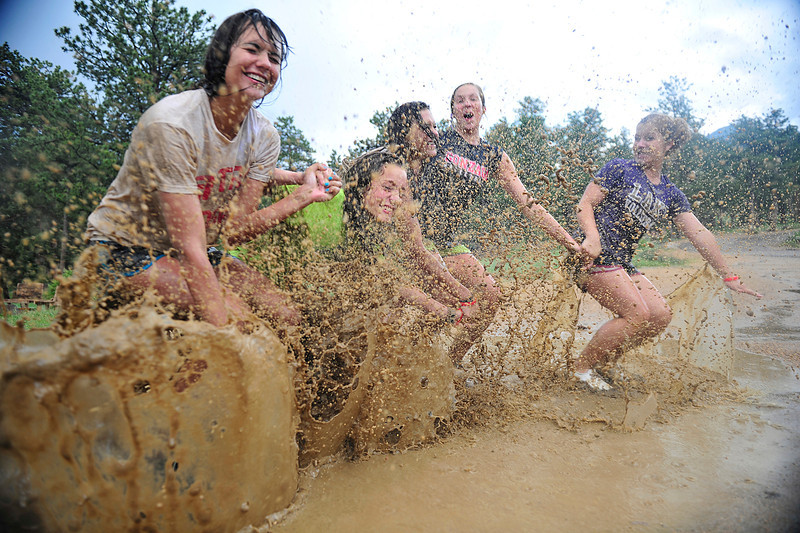 Walt Hester | Trail Gazette<br /> Girls at the YMCA of the Rockie take a little time to frolic in a puddle created by Wednesday afternoon's downpours. From left they are Brooke Pahukoa, 16, Mikayla Powers, 16, Brittney Pahukoa, 16, Courtney Ball, 16, and Ciara Carter, 16, all from Port Stevens, Wash.