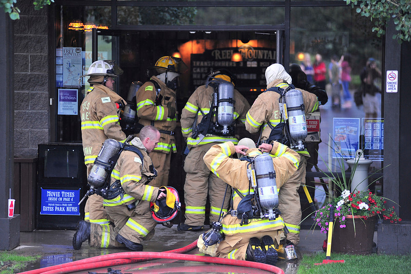 Walt Hester | Trail Gazette<br /> Firefighters prepare to re-enter the Reel Mountain Theater to investigate the cause of smoke in the building. Employees called in a report of smoke at 1:21 on Wednesday, then evacuated the building.