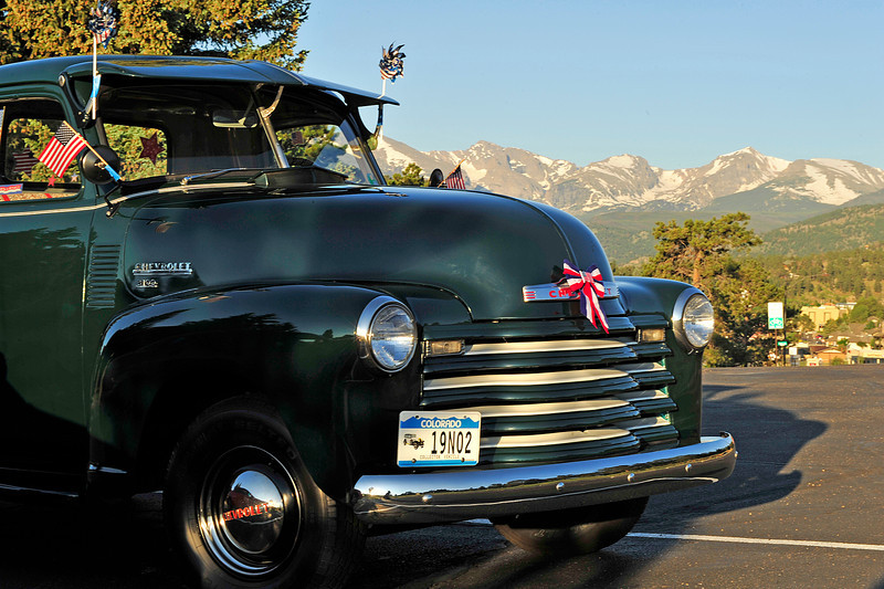 Walt Hester | Trail Gazette<br /> A patriotically bedecked classic Shevy pickup greets visitors at the Our Lady of the Mountains Catholic Church on Monday. Estes Park flew flags and donned stars and stripes for Independence Day.