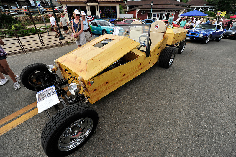 Walt Hester | Trail Gazette<br /> A wooden, coffin-shaped roadster attracts curious car fans at the annual car show on Monday. Paint jobs, stereos and creative modifications make the Coolest Car Show a joy to visiting enthusiasts.