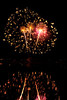 Walt Hester | Trail Gazette<br /> Fireworks arch into the sky over Lake Estes on Monday. The annual show swells the population of Estes Park and snarls traffic for a few hours every year.