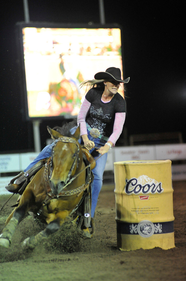 Walt Hester | Trail Gazette<br /> Jill Franzen leans around the last barrel before heading home on Wednesday night. Franzen has grown up in rodeo with her brother, John, who competed in Steer Wrestling, and her parents, Hank and Lori, own the Powder River Rodeo Company.