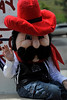 "Walt Hester | Trail Gazette<br /> ""Dusty,"" the official mascot of the Rooftop Rodeo waves to fans at the parade on Tuesday."
