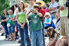 Walt Hester | Trail Gazette<br /> Micah Testa, 8, of East Lancing, Mich., snaps a shot of the passing Rooftop Rodeo Parade on Tuesday. The parade is one of the bigger events in Estes Park every summer.