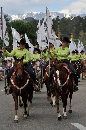 Walt Hester | Trail Gazette<br /> The Cheyenne Dandies represent their rodeo along Elkhorn Avenue on Tuesday. The Dandies are the official ambassadors of the Cheyenne Frontier Days.