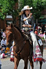 Walt Hester | Trail Gazette<br /> McKenzie Haley of Winner, SD, 2011 Miss Rodeo America, waves to the assembled fans along Elkhorn Avenue on Tuesday. Haley will spend some time in Estes Park as part of the 85th Rooftop Rodeo.