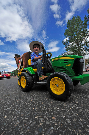 Walt Hester | Trail Gazette<br /> An espiring young farmer drives his little tractor down Elkhorn Avenue during the Rooftop Rodeo Parade on Tuesday. The 85th Rooftop Rodeo runs each night through Sunday begining at 7:30.