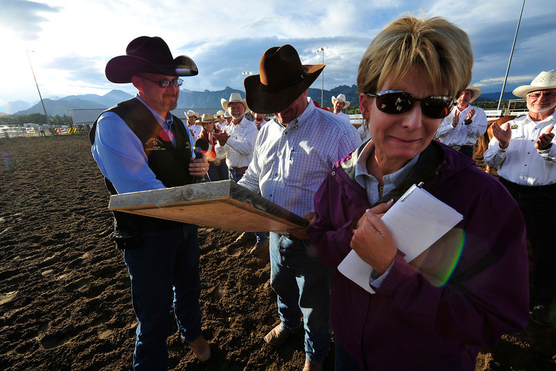 Walt Hester | Trail Gazette<br /> Lori Franzen gets a little emotional on Tuesday night as Bo Winslow presents her and husband Hank Franzen with a plaque signed by the entire Rooftop Rodeo Committee. The Franzen's Powder River Rodeo Company is the long-time provider of rough stock to the rodeo.