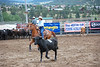 A rider turns back to the task of helping her teammates cut another animal from the herd during the July 9 Rocky Mountain Team Penning Association competion held in Estes Park.