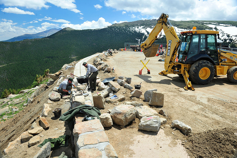 Walt Hester | Trail Gazette<br /> National park road crews rebuild a retaining wall at Rainbow Curve on Friday. Each individual stone was numbered as it was removed so workers can reassemble the stones in the same order, as the wall is concidered an historic structure in the park.