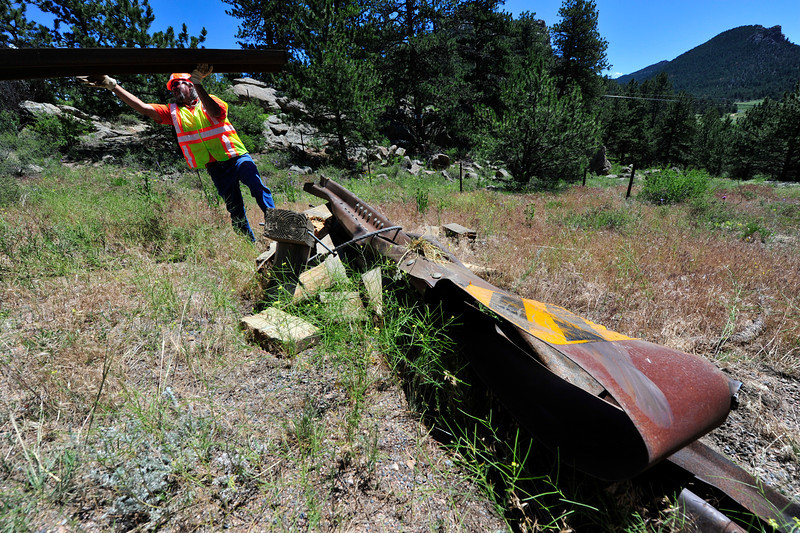 Walt Hester | Trail Gazette<br /> Bob Parish of the Colorado Department of Transportation loads up the mangled remains of a guard rail on Wednesday. A truck carrying hay hit the rail just outside of the town limits on Hwy 34.