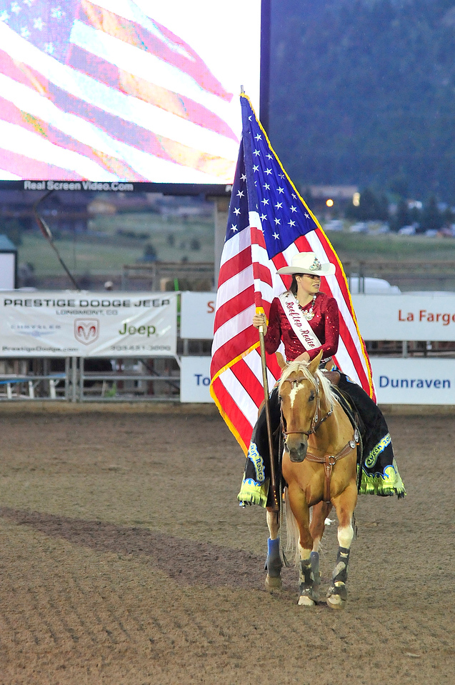 Walt Hester | Trail Gazette<br /> Rooftop Rodeo Queen for 2011, Cassie Fisher, is wrapped in Old Glory on Saturday night.