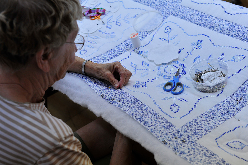 Walt Hester | Trail Gazette<br /> Donna Zieman of the Hilltop Guild works on needle point on a quilt on Wednesday. The quilt will be sold at the annual Hilltop Guild festival and Bizaar on Saturday, August 6.