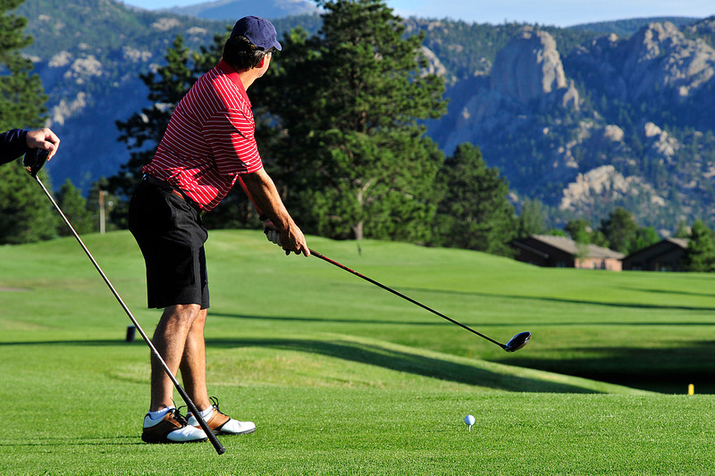 Walt Hester | Trail Gazette<br /> A golfer prepares to drive toward Lumpy Ridge on the Estes Park Public 18-Hole Course on Tuesday.