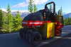 Walt Hester | Trail Gazette<br /> A roller lets traffic by before resuming work on Trail Ridge Road on Tuesday. The National Park's roads crew is resurfacing the road between Rainbow Curve and Deer Ridge Junction.