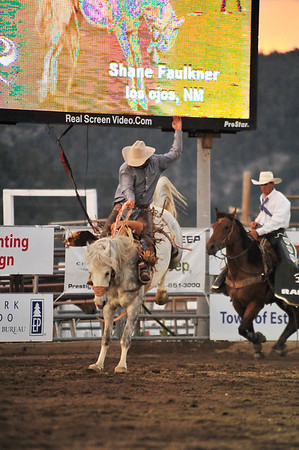 Walt Hester | Trail Gazette<br /> Shane Faulkner of Los Ojos, NM, hangs on during the saddle Bronc event on Thursday.