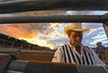 Walt Hester | Trail Gazette<br /> A Professional Rodeo Cowboy Association judge writes down scores as another Estes Park sunset lights the sky behind him on Saturday. There is more to a rodeo than most fans get to see every night.