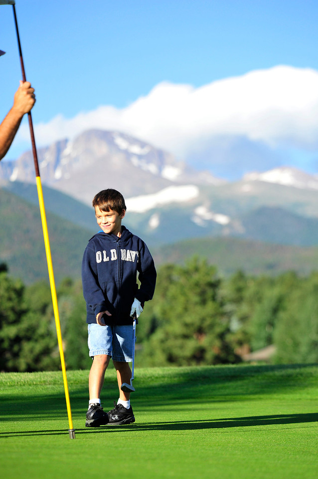 Walt Hester | Trail Gazette<br /> Tyler Tubyk, 6, of Dallas, seems pleased with his put on the third hole of the Estes Park Public 18-Hole Golf Course on Tuesday.
