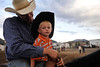 Walt Hester | Trail Gazette<br /> Little cowboy Krew Karney, 2, of Ordway, Colo., enjoys a moment with his father, Tyler, before Friday's Rooftop Rodeo. Just as ranching and the cowboy way of life is a family affair, so is the sport of rodeo.