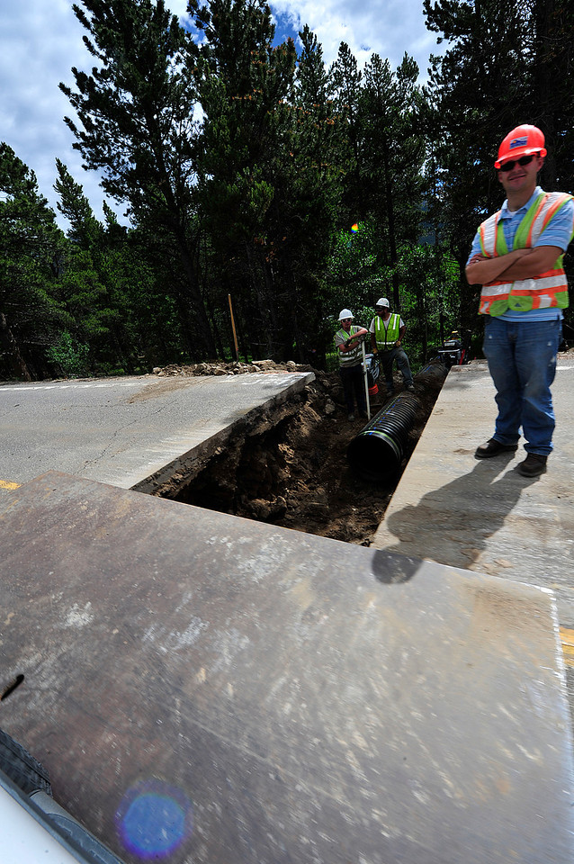 Walt Hester | Trail Gazette<br /> Colorado Department of Transportation crews work on Hwy 7 between the Longs Peak Road and Allenspark in Boulder County on Wednesday. Crews generally work during the week and patch up the pavement for weekend traffic.
