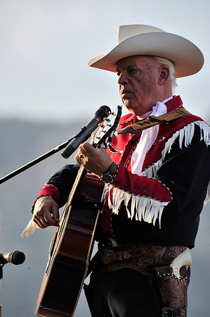 Walt Hester | Trail Gazette<br /> Cowboy singer Ron Ball entartains Thursday night before the rodeo. Ball sang the National anthem, at Kellsie Purdy's request, at the National Western Stock Show when Purdy was crowned Miss Rodeo Colorado.
