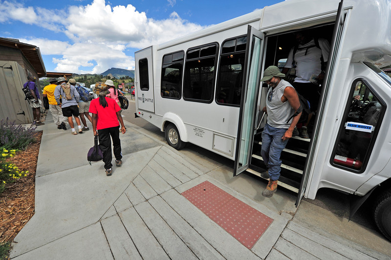 Walt Hester | Trail Gazette<br /> Members of the Los Angelese-Based 4SW Ski Club step off of the free shoppers' shuttle on Thursday morning. The shuttle runs from 10 a.m. every half-hour until 6:30, then once an hour 'til 8:30.