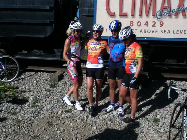 Walt Hester | Trail Gazette<br /> Members of the Ponzio Pedalers pose at the Climax Mine memorial on Fremont Pass on Monday. The team, which raised over $100,000, takes a design created by a young patient to decorate their jerseys.