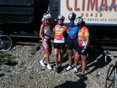 Walt Hester | Trail Gazette Members of the Ponzio Pedalers pose at the Climax Mine memorial on Fremont Pass on Monday. The team, which raised over $100,000, takes a design created by a young patient to decorate their jerseys.