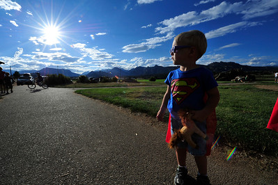 Walt Hester | Trail Gazette Daniel Foreman pauses in his Superman t-shirt and cape before charging toward the playground at the Stanley Park on Wednesday. A cloudy day gave wy to the sunny evening.
