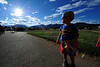 Walt Hester | Trail Gazette<br /> Daniel Foreman pauses in his Superman t-shirt and cape before charging toward the playground at the Stanley Park on Wednesday. A cloudy day gave wy to the sunny evening.
