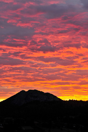 Walt Hester | Trail Gazette<br /> Tuesday's sunrise blazes over Mount Olympus. Pink and orange gave way to gray as the day progressed, with warm temperatures and a chance of shower.