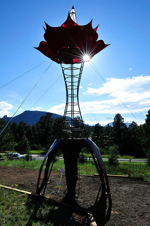 Walt Hester | Trail Gazette<br /> Sunshin finds a way through the Tower of Tranformation on Wednesday. The sculpture, created by Joe Arnold, will be on display near Fish Creek and Brodie Avenue for about a week before it is dismanteled and moved to Nevada for the Burning Man festival.
