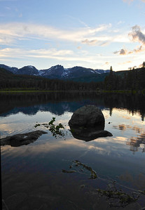 Walt Hester | Trail Gazette Evening light fades over the Continental Divide and Sprague Lake on Wednesday. Heavy spring runoff deposited much debris into the lake.