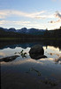 Walt Hester | Trail Gazette<br /> Evening light fades over the Continental Divide and Sprague Lake on Wednesday. Heavy spring runoff deposited much debris into the lake.