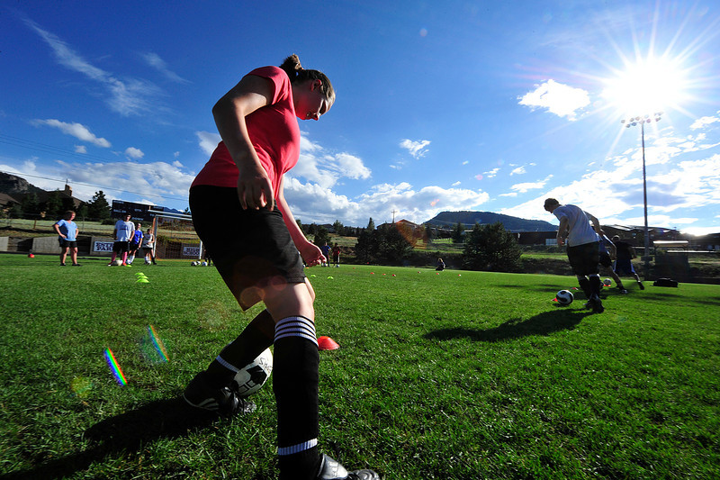 Walt Hester | Trail Gazette<br /> Estes Park high school soccer players dribble around cones during a preseason camp on Wednesday. The camp, run by Colorado College assistant coach James Wagenschutz, was made possible by a host of sponsors including Airbits, Christian Collinet of First Colorado Realty, Rodeway Inn, Poppy's and Mama Rosa's, Mike Richardson and Kris and Gary Hazelton.