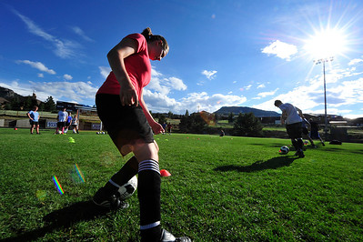 Walt Hester | Trail Gazette Estes Park high school soccer players dribble around cones during a preseason camp on Wednesday. The camp, run by Colorado College assistant coach James Wagenschutz, was made possible by a host of sponsors including Airbits, Christian Collinet of First Colorado Realty, Rodeway Inn, Poppy's and Mama Rosa's, Mike Richardson and Kris and Gary Hazelton.