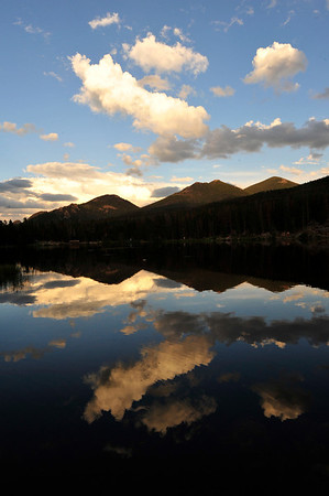 Walt Hester | Trail Gazette<br /> Clouds and blue sky reflect off of Sprague Lake as afternoon fades into night on Wednesday. The shallow lake is a favorite among national park visitors, as well as elk and moose.