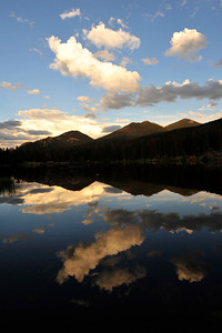 Walt Hester | Trail Gazette Clouds and blue sky reflect off of Sprague Lake as afternoon fades into night on Wednesday. The shallow lake is a favorite among national park visitors, as well as elk and moose.