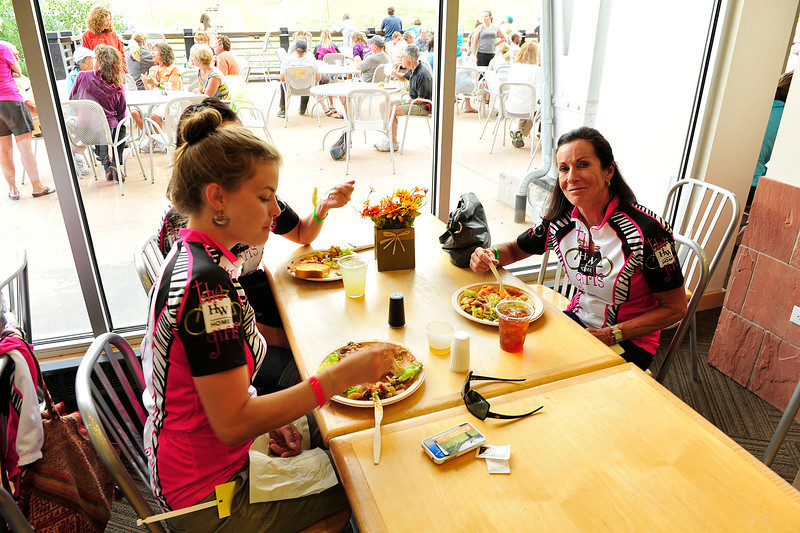 Walt Hester | Trail Gazette<br /> Beverly Needham, right, captain of the HW Home Girls displays her team's pink and zebra-striped jerseys. The team raised more than $14,000.
