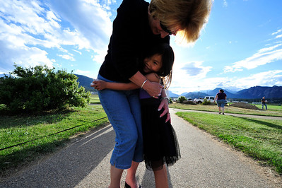 Walt Hester | Trail Gazette Deb Richardson, a K-First Grade Looping teacher, hugs student Amelia Goodwin, 6, at a gathering of students and parents at the Stanley Park playground on Wednesday. The informal gathering was a chance to reconnect for students, parents and Richardson.