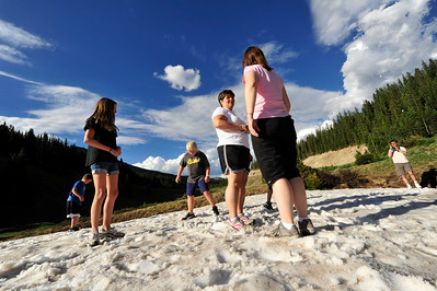 Walt Hester | Trail Gazette The Smith family of Banson, Mo., and Siler family of Kansas City, marvel at the snow remaining at Milner Pass on Monday. A conciderable amount of snow remains from the heavy winter and spring snow at the higher elevations of the Rockies.