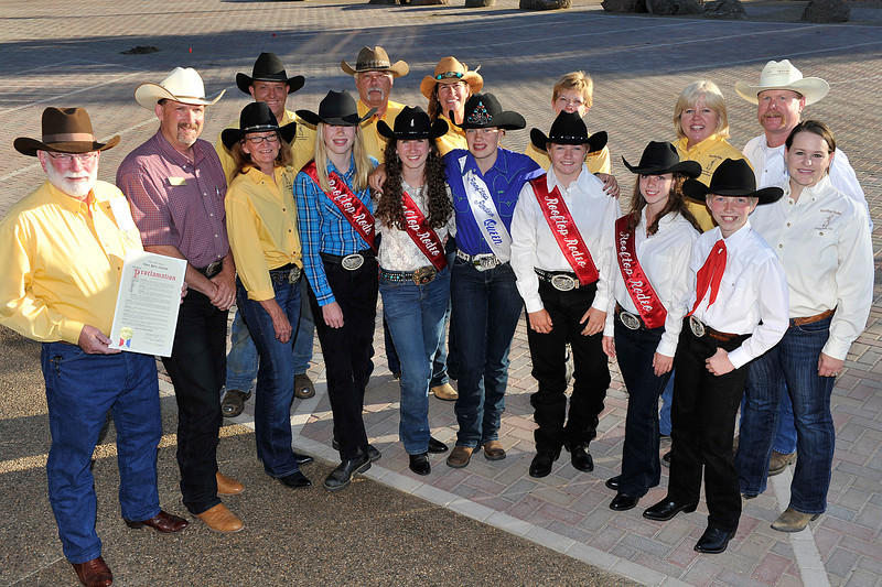 "Walt Hester | Trail Gazette<br /> Members of the Rooftop Rodeo Committee show off the Mayor's Proclamation in front of Town Hall on Tuesday evening. July 12-17 has ben proclaimed ""Rooftop Rodeo Week"" in Estes Park."