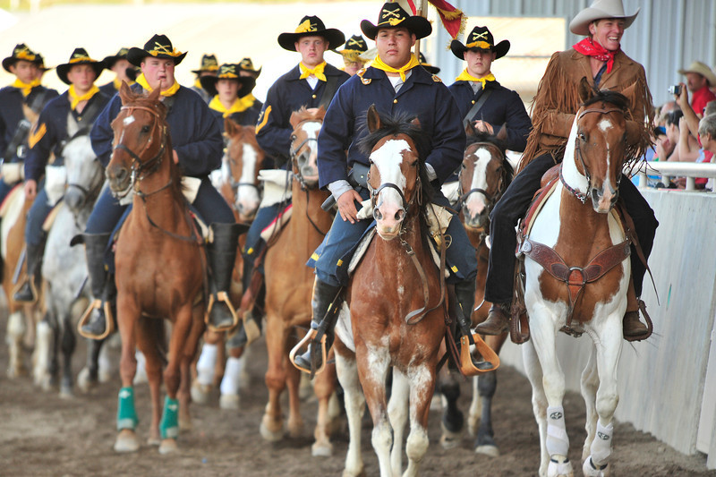 Walt Hester | Trail Gazette<br /> The 7th Cavalry gallups into the arena. The Westernaires demonstrait horseman of history, as well as the precision of the present.