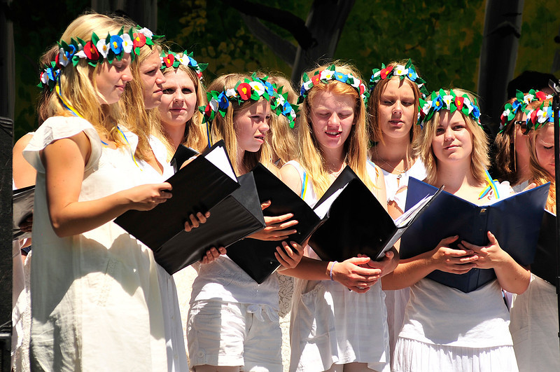 Walt Hester | Trail Gazette<br /> A Swedish children's chior perform in Bond Park on Saturday. Music, food and various Scandinavian art and gifts filled the park during the annual Scandinavian Midsummer Festival.