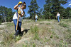 Walt Hester | Trail Gazette<br /> Kaitlyn Otteson, 16, of Decorah, Iowa, helps dig up unwanted vegetation near the Lumpy Ridge Trail head on Tuesday. Youths from Northeast Iowa numbered 45, and helped Rocky Mountain National Park with its weeds.