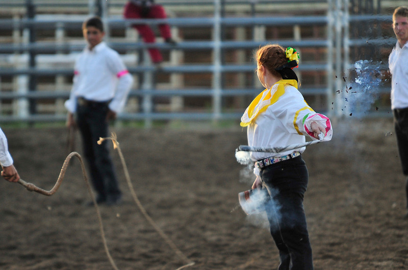 Walt Hester | Trail Gazette<br /> A bull whip knocks the flame out during a demonstration by one of the Westernaires' specialty teams. Chariots, bull whips, trick ropers and several more specialty teams are part of the Westernaires.