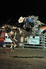 Walt Hester | Trail Gazette<br /> A bull rider negates his ride by touching the bull with his free hand. Bull riding is the most popular and dangerous event within professional rodeo.