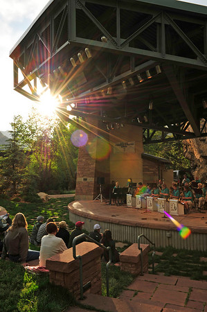 Walt Hester | Trail Gazette<br /> Warm summer sun bursts through clouds and the roof og the Performance Park stage on Wednesday. The Estes Park Jazz Big Band performed to the delight of the crowd.